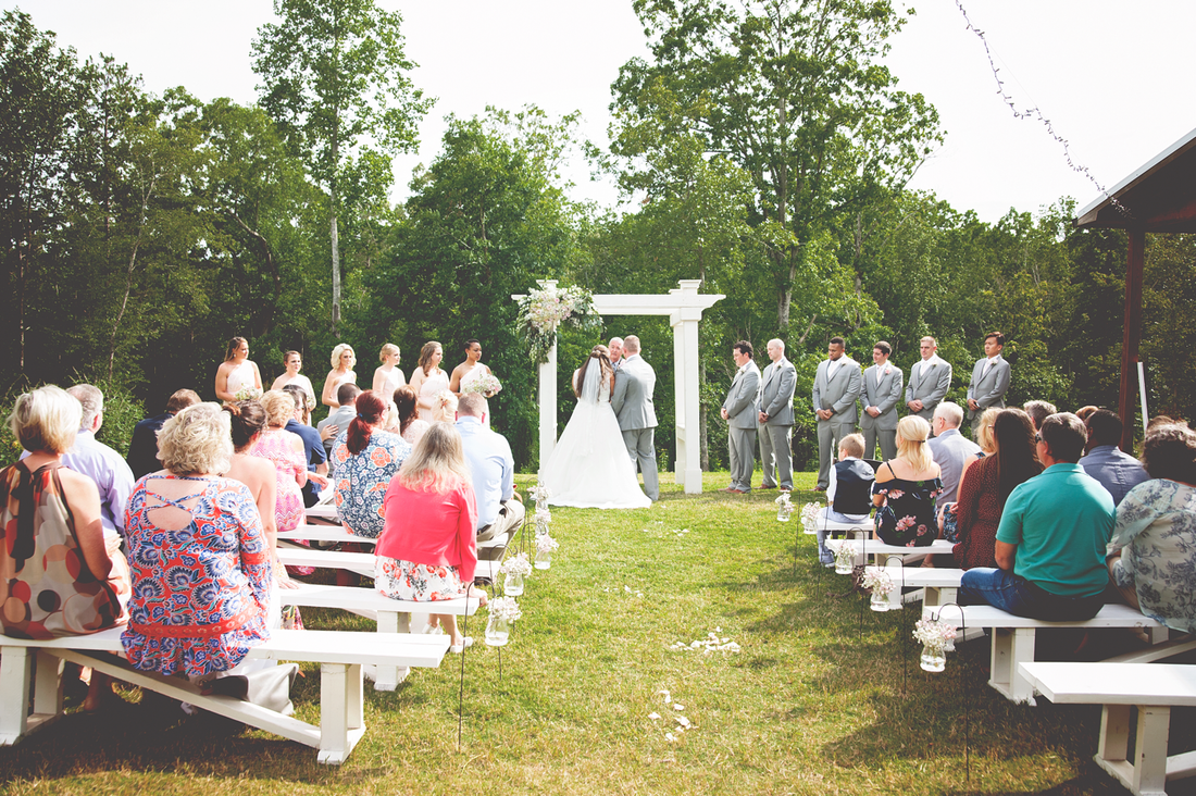 Spring outdoor ceremony at farm wedding venue in North Georgia